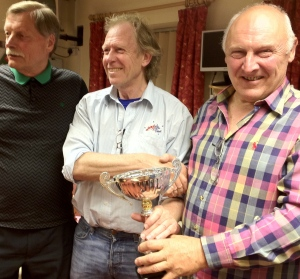 David Wing, centre, presents the City Cup to Wolverhampton Bridge Club members Geoff Davies and Robin Adey