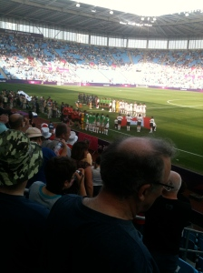 Japan and Canada's football teams line up before the start of their Olympics group match at the City of Coventry stadium
